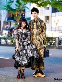 Stylish Japanese duo in head-to-toe Vivienne Westwood printed street styles in Harajuku.
