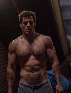 Henry Cavill kinda looks like a less attractive Matt Bomer in the face but, that body is sexy!!