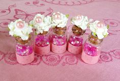 Large Fairy Dust Jar Party Favor Jar Set- with cork, white paper millinery flower and pearl top on Etsy, $23.00