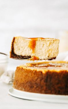 This salted caramel cheesecake is seriously the best cheesecake recipe ever. It's silky smooth, extra creamy, and covered in a delicious homemade salted caramel. You definitely need to make this! #cheesecake #saltedcaramel #cheesecakerecipe #butternutbakery Salted Caramel Cheesecake, Best Cheesecake, Caramel Cupcakes, Cheesecake Cupcakes, Delicious Desserts, Dessert Recipes, Delicious Cupcakes, Dessert Food, Cheesecakes