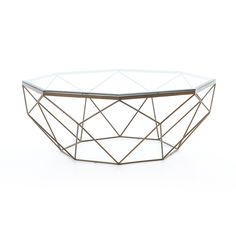 Geometric coffee table with simple lines celebrate negative space with the glamour of sparkling glass and antiqued brass.