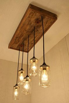 Beautifully Crafted Farmhouse Chandelier, Mason Jar Lighting, With Reclaimed Wood and 5 Pendants, homedecorationliv. deals in unique lighting system to make your best interior kitchen decoration like kitchen lighti. Small Kitchen Lighting, Kitchen Lighting Fixtures, Country Kitchen Lighting, Outdoor Light Fixtures, Farmhouse Lighting, Ceiling Fixtures, Mason Jar Chandelier, Mason Jar Lighting, Mason Jar Pendant Light