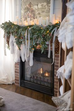 A cozy Christmas mantel with greens, candlelight, and cream stockings. Front Door Christmas Decorations, Ribbon On Christmas Tree, Cool Christmas Trees, Christmas Mood, Beautiful Christmas, Xmas, Outdoor Christmas, Christmas Snowman, Christmas Stuff
