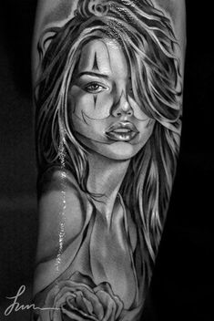 Image result for tattoo of female face on arm in a car