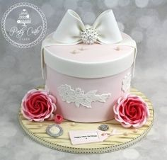 Vintage Hatbox Birthday Cake With Crystal Bow And Roses. - http://pontycarlocakes.com/vintage-hatbox-birthday-cake-with-crystal-bow-and-roses/ #Birthdaycake, #Bling, #Cake, #Cameo, #Cardiff, #Crystals, #Ganache, #Hatbox, #Lace, #Pearls, #Pink, #Pontycarlocakes, #Pontypridd, #Rose, #Rosebuds, #Roses, #Sharpedge, #Vintage