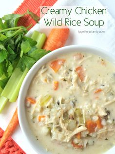 Creamy Chicken & Wild Rice Soup- cooks in the slow cooker all day and it's so creamy and flavorful! www.togetherasfamily.com