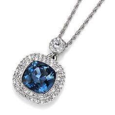 "Stunning Pendant made of rhodium plated metal. The Star of the Pendant is a sparking Denim blue Swarovski Crystal that measures approx. .5""by .5"" and is surrounded by a double layer of shimmering smaller Crystals."