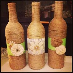 Bottles wrapped in twine- Jordan's centerpieces!