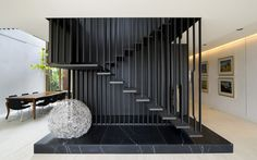 Floating black staircase in Melbourne by Chamberlain Javens Architects.