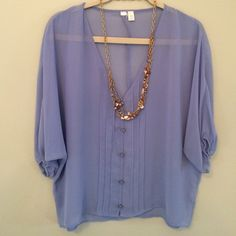 Sheer Lavendar Layering Blouse Soft and feminine sheer blouse. Three-quarter length sleeves. Button front detail. Purchased at a boutique. Size medium runs big or very blousy Tops Blouses