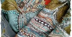 Amazingly complex pattern of quilting and embroidery with embellishments.