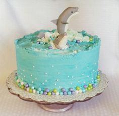 Dolphin cake. https://m.facebook.com/BakedBlissCrosby/
