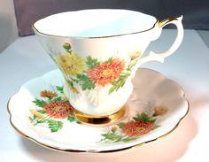 Royal Albert English Fine Bone China Chrysthanemum Vintage Teacup & Saucer Set - Gold Orange Flowers - Friendship Pattern - white - yellow. $15.50, via Etsy.