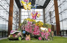 Emanuel Ungaro chose highly visual ornamentation, with a catwalk made out of fresh grass and Seventies inspired cars under mountains of multicoloured flowers and huge butterflies