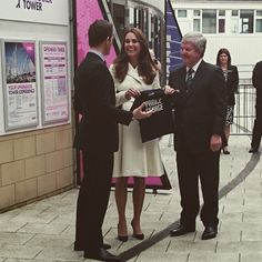 The Duchess of Cambridge receives a miniature version of the Ben Ainslie Racing team kit for Prince George