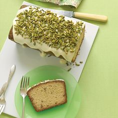 We have updated the standard loaf with a few additions. Cream cheese makes the cake wonderfully moist, while ground pistachios lend the batter a distinct nutty flavor and faint green tinge. Drizzled with icing and sprinkled with pistachio slivers, this cake couldn't be more appropriate for the season.