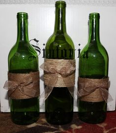 Wine bottle decoration with twine and rustic ribbon - use as vase or add Christmas lights.