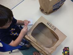 NASA Astronaut Helmets made out of paper bags - dramatic play fun!