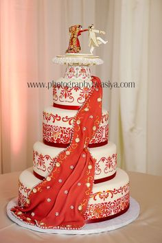 Awesome Indian wedding cake. ~love this! But to make it more elegant I would just remove the characters on the top!