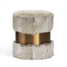 So chic and so versatile, the Scarlett Stool features sophisticated grey goat hair accented with stainless steel in an antique bronze finish. Bronze Finish, Bar Stools, Goats, Ottoman, Armchair, New Homes, Stainless Steel, Antiques, Grey