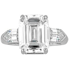 5.38 Carat GIA Cert Emerald Cut Diamond Platinum Ring    From a unique collection of vintage three-stone rings at https://www.1stdibs.com/jewelry/rings/three-stone-rings/