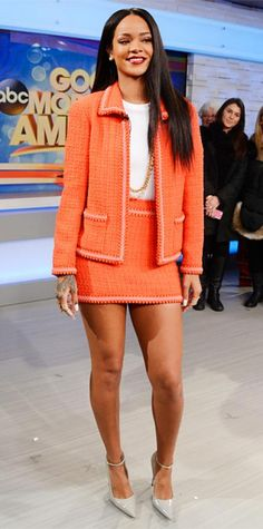 JANUARY 30, 2014 Rihanna WHAT SHE WORE After an ultra-glam pre-Grammy look, Rihanna went in a decidedly more conservative direction with an orange tweed Chanel skirt set, styling it witha ribbed white Adam Selman bodysuit, a gold chain necklaces, a selection of armor rings and gray ankle-strap Manolo Blahniks