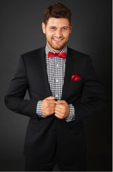 Black slim fit dinner suit. Two button notch lapel with side vents. Red bowtie
