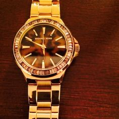 MK5723 Gramercy Gold Tone Glitz Tortoise Dial Beautiful oversized watch! Has a patterned dial set on a sparkling embellished topring. A plated steel bracelet completes the look. Gently worn, original tags and box. Out of stock everywhere!!! Michael Kors Jewelry