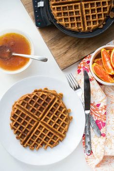 Soft tender sweet potato waffles are a perfect match for orange-spiked maple syrup. You'll want these for breakfast lunch and dinner! These freeze really well and we add enjoy life chocolate chips for our youngest Sweet Potato Waffles, Paleo Sweet Potato, Pancakes And Waffles, Whole 30 Breakfast, Paleo Breakfast, Breakfast Recipes, Waffle Recipes, Paleo Recipes, Free Recipes