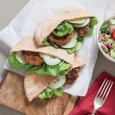 Lamb and Red Pepper Pita Sandwiches | MyRecipes.com  -  Folding feta into the lamb mixture adds a salty tang to the patties.  To perfectly compliment this healthy sandwich, Serve with a Mint and Pistachio Tabbouleh.  Click on the link above for the recipe.  ENJOY!
