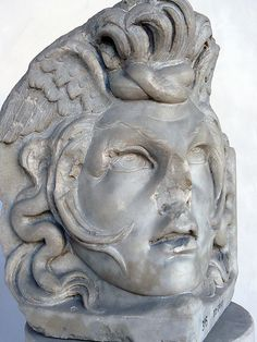 Acroterium corner stone of a Roman sarcophagus depicting the head of Medusa reclaimed from the Tiber Luni Marble 170-190 CE