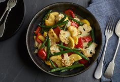 1 tlbs. olive oil , 1/2 cup red bell pepper, 1 cup sliced cauliflower , 1 1/2 cups green beans,  1 1/2 cups yellow squash,  2 cloves garlic, minced , 1 cup Chicken Broth,  Heat  oil in skillet on high heat.  Add  red pepper, cauliflower, green beans & squash Cook 4 mins .  Add garlic & cook 1 min. Add broth & heat to a boil, Reduce  heat to med-high. Cook for 3 mins.