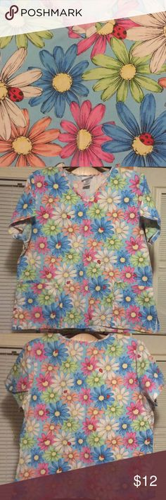 SB 🌻 COTTON BLEND DAISY FLORAL SCRUB TOP XL Excellent pre-owned condition daisy floral scrub top by SB SCRUBS. Size women's XL. Colors: pink orange yellow blue red green white wIth lady bugs. Needs a wash and an iron due to being in plastic bins in dry storage container. No odor! FEEL FREE TO MAKE AN OFFER! BUNDLE DISCOUNT on 3 ITEMS or MORE! SB Scrubs Tops Tunics