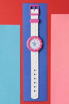 Give the gift of star power with this sparkling white watch for kids. Gemstones pave their way around the dial of BLEUE ETOILÉE (ZFCSP076), and its shocking pink rotating bezel is guaranteed to turn heads. Learning to tell the time will be a vivid dream with the watch's colour-coordinated hands and numbers. Vivid Dream, Telling Time, Swatch, Numbers, Sparkle, Hands, Colour, Gemstones, Star