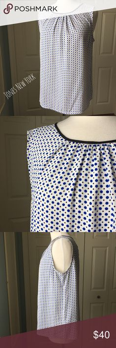 """White Polka Dot Print Sleeveless Blouse Feminine and versatile white polka dot printed sleeveless blouse by Jones New York. ▪️26"""" long ▪️23"""" pit to pit ▪️In great condition  🚭 Smoke-free home 📬 Ships by next day 💲 Price negotiable  🔁 Open to trades  💟Happy Poshing!💟 Jones New York Tops Blouses"""