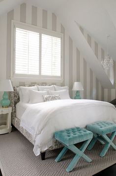 Gray and turquoise bedroom. Love the damask fabric-covered bed!