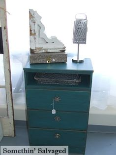 Somethin' Salvaged upcycled dresser with faucet handle knobs