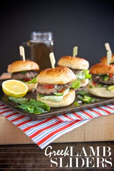Greek Lamb Sliders with a whipped feta sauce & a Greek salad relish.  Check out more at Shutterbean.com