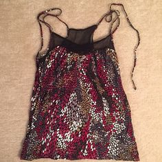 Guess Mesh and Dots Tank Top Small Top is a tank top that also ties. Mesh on the front and back. Great condition. Size small. Guess Tops Tank Tops