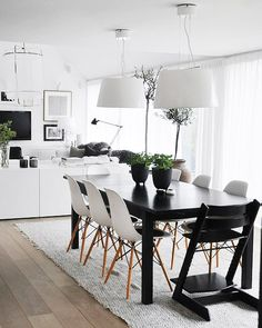 cheap dining table. spray paint black... saarinen chairs.  Love oversized shade