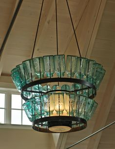 House of Turquoise: The Cushman Design Group.  Beautiful turquoise chandelier made with mason jars.