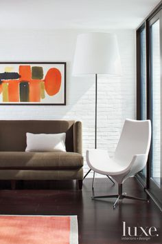 Contemporary White Sitting Area with Orange Artwork