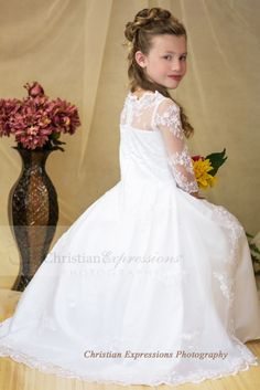 First communion gown made of satin with organza overlay Available exclusively through Christian Expressions.  http://www.firstcommunions.com/first-communion-dresses-8020.aspx