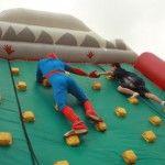 Hoosier superhero: Spiderman helping a young boy on the rock climbing wall