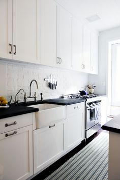 I like the white painted brick, and the slate countertops.