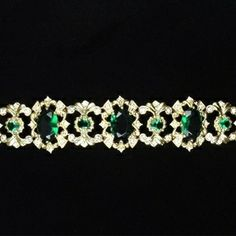 """This bracelet was a gift from JFK """"fit for a princess"""", and belonged to America's princess, Jacqueline Kennedy. This work of art was typical of the emerald jewelry favored by the Irish-American Kennedy family. All of JFK's great-grandparents emigrated to the U.S. from Ireland and within one generation, each enjoyed phenomenal success."""