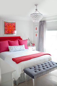 Gray & white guest bedroom with pops of red and pink