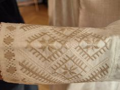 Hand embroidered cuffs of Latvian folk costume. Morning star auseklis pattern.
