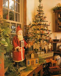 Santa stands vigil next to the vintage Christmas tree. Old tree with fence Old World Christmas, Prim Christmas, Old Fashioned Christmas, Christmas Past, Victorian Christmas, Vintage Christmas Ornaments, Country Christmas, Winter Christmas, German Christmas Decorations