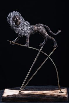 The Nemean lion was inspired by the twelve (12) labors of Hercules, specifically it was his first labor. This sculpture, made out of clay, as well as its metal base was sculpted by the artist, and represents Hercules's arrow which according to the myth, was the first thing he used to kill the lion. #sculptures #bronze #lion